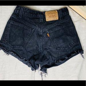 Vintage black Levi 562 shorts.